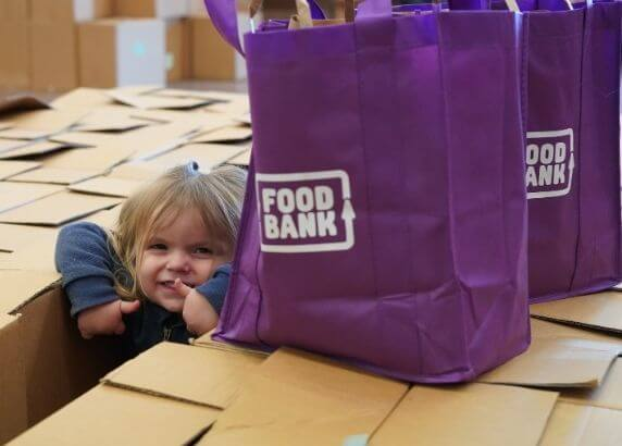 Young girl with Foodbank hamper