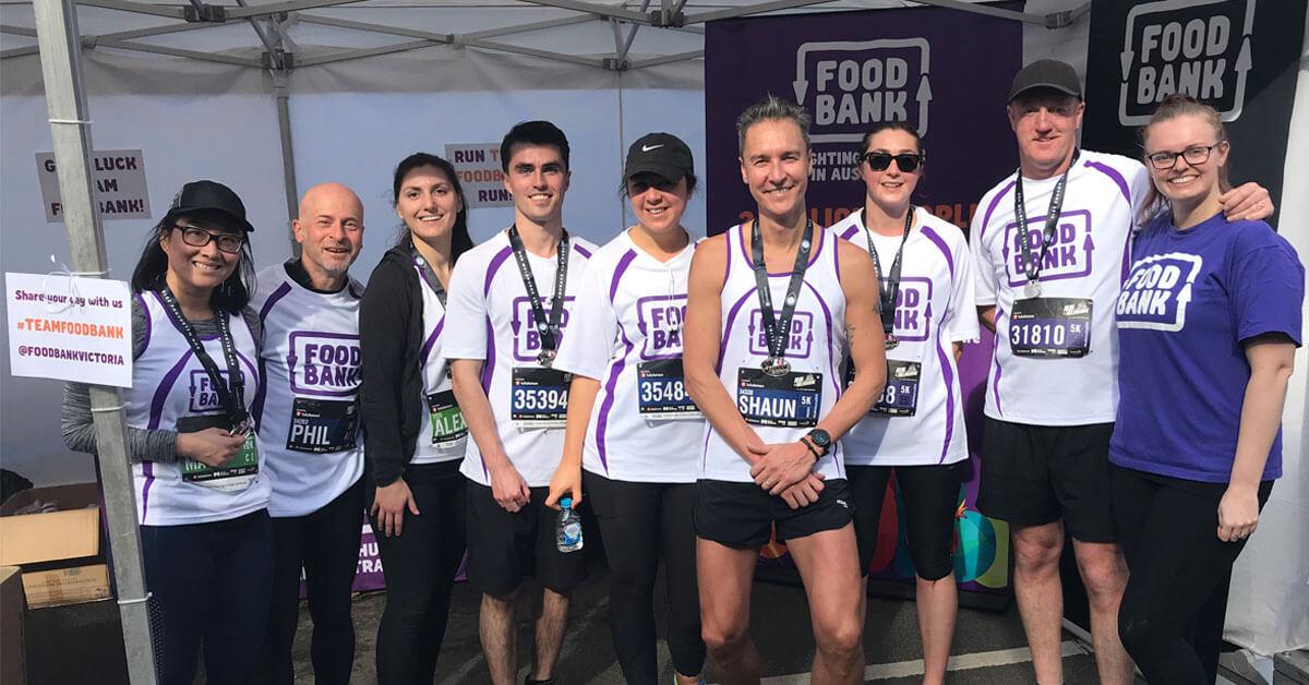 Foodbank team members celebrating after completing Run Melbourne